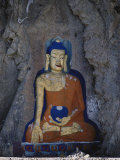 A Painted Stone Buddha Near Lhasa, Tibet Photographic Print by Gordon Wiltsie