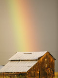 A Rainbow Arches from the Sky onto a Barn Photographic Print by Michael S. Lewis