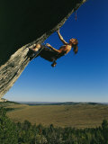Young Woman Climbing the Rock Feature Called Bobcat Logic Photographic Print by Bobby Model