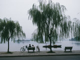 Bicyclists Enjoy the View in a Hangzhou Lakeside Park Photographic Print by James L. Stanfield