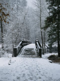 A Snow-Covered Footbridge over the Merced River Photographic Print by Marc Moritsch