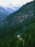 The Canada Pacific Train Travels Through Kicking Horse Pass Photographic Print by Michael Melford