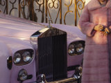 A Woman Wearing a Pink Mink Coat Stands Next to a Pink Rolls Royce Photographic Print by Jodi Cobb