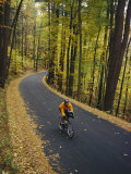 A Cyclist Riding Along a Rural Road in the Fall Photographic Print by Skip Brown