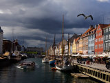 Tourist Boat Cruises Nyhavn, New Harbor, Along the Scenic Canal in Copenhagen Photographic Print by  Keenpress