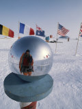 Flags of Many Nations and a Ceremonial Globe at the South Pole Photographic Print by Gordon Wiltsie