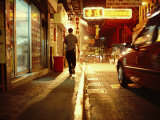 Man and a Taxi on a Shop-Lined Hong Kong Street at Night Photographic Print by  xPacifica