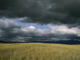 Dark Clouds Gather over a Prairie in the National Bison Range Photographic Print by Annie Griffiths Belt