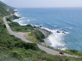 A Car Whizzes Down Hwy 1 Along Californias Big Sur Coastline Photographic Print by Rich Reid
