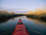 The Bow of a Kayak Leads the Way Through a Marsh Channel Reproduction photographique par Skip Brown