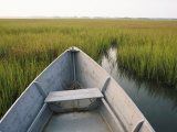 The Bow of a Rowboat Slices Through the Marsh Grass Photographie par Skip Brown