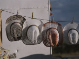 Cowboy Hats Hang on a Clothesline at a Festival in Santa Fe Photographic Print by Jodi Cobb