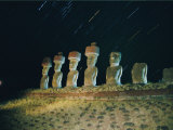 A View of the Night Sky and Illuminated Moai Photographic Print by Richard Nowitz
