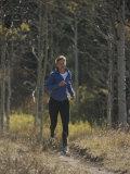 A Runner Takes an Autumn Jog Along Cache Creek Reproduction photographique par Bobby Model