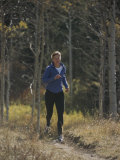 A Runner Takes an Autumn Jog Along Cache Creek Fotografisk trykk av Bobby Model