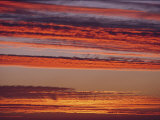 Clouds Lit up by a Brilliant Sunset Photographic Print by Robert Madden