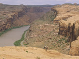 Mountain Bikers on Slickrock Trail Overlooking the Colorado River Photographic Print by Rich Reid