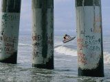 Graffiti-Covered Pilings Photographic Print by Robert Madden