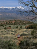 A Runner on the Hidden Valley Trail Above Moab, Utah Photographic Print by Bill Hatcher
