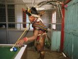 A Huli Wigman Plays Pool in a Pub During the Annual Sing-Sing in Goroka Photographic Print by Jodi Cobb