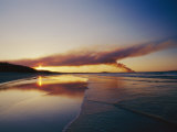 Smoke from a Brushfire Forms a Large Cloud over a Shoreline Bathed in Low Sunlight Photographic Print by Jason Edwards