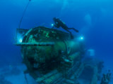 A Diver Swims Around the Submerged Research Station, Aquarius Fotografisk tryk af Brian J. Skerry