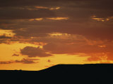 Low Sunlight Colors the Sky and Clouds in Shades of Orange Photographic Print by Raymond Gehman