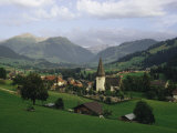 A Pastoral View of a Village in the Swiss Alps Stampa fotografica di Blair, James P.