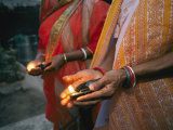Women Hold Votive Lamps in Their Hands Photographic Print by Karen Kasmauski