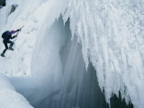 A Man Climbs Outside a Snow Cave Photographic Print by Dugald Bremner
