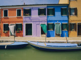 A View of the Brightly Colored Buildings of Burano with Gondolas Floating at Their Doorsteps Photographic Print by Richard Nowitz