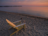 Beach Chair Facing the Water at Twilight Photographic Print by Bill Hatcher