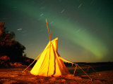 Illuminated Teepee under the Northern Lights Photographic Print by Raymond Gehman
