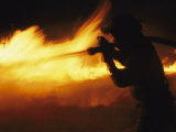 Fire-Fighter Battling a Blaze at Night Photographic Print by Mark Thiessen