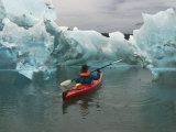 A Kayak Paddler Passes Sculpted Icebergs in Tracy Arm Fjord Photographic Print by Ralph Lee Hopkins