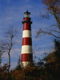 The Assateague Island Lighthouse Against a Blue Sky Photographic Print by Raymond Gehman
