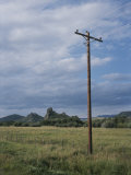 A Power Line Runs Through a Field Photographic Print by Taylor S. Kennedy