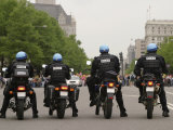 Police Officers Stand Sentinel Before a Crowd Fotografisk tryk af Jim Webb