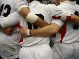Rugby Players Huddle in a Scrum at the Annual Rugby Sevens Lmina fotogrfica por Eightfish