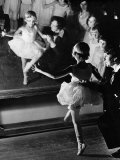 Ballet Teacher Advising Little Girl and Group of Dancers at Ballet Dancing School Look On Premium Photographic Print by Alfred Eisenstaedt