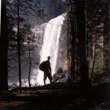 Hiker Looking at Vernal Falls in Yosemite National Park Photographic Print by Ralph Crane