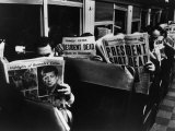 Commuters Reading of John F. Kennedy&#39;s Assassination Photographic Print by Carl Mydans