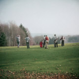 Golfers Playing on Golf Course Photographie par Walker Evans