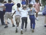 At the Desegregated Lusher School Three Boys Display Camaraderie Walking Through Playground Lámina fotográfica por Bill Eppridge