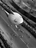 Looking Down Onto Fish Balloon and Crowds Lining Street During Macy's Thanksgiving Day Parade Photographic Print by John Phillips
