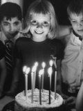 Little Girl Blowing Out Her Candles on Her Birthday Cake Premium Photographic Print by Robert W. Kelley
