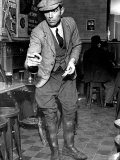 Man Playing Quoits, Like Horse Shoes, in an English Pub Premium Photographic Print by Hans Wild