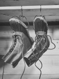 Mail Order Co. L. L. Bean's Famous Maine Hunting Shoe Hanging from Boot Holders For Quick Drying Photographic Print by George Strock