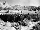 Georgia O'Keeffe Climbing a Ladder Outside Ghost Ranch, Her Desert Home Premium Photographic Print by John Loengard