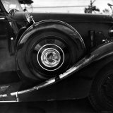 Spare Tire Stored on Side Fender of an Automobile Photographic Print by Walker Evans